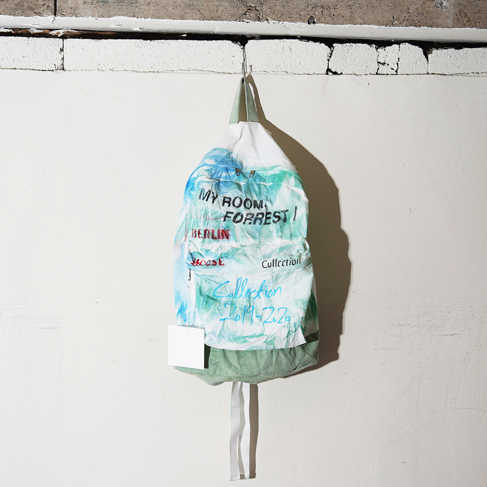 "THE MUSEUM VISITOR Sprayed Backpack ""Off-White"""
